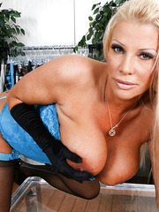 Hot mature porn star with big tits JR Carrington poses in beautiful lingerie