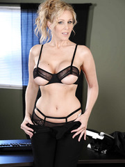 Astounding blonde woman Julia Ann poses and touches her shaved pussy in amazing lingerie