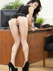 Asian secretary Mia Lelani enjoys to pose naked right in her office