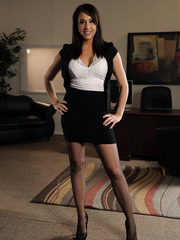 Great milf Chanel Preston poses in beautiful stockings on sexy high heels