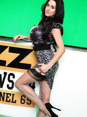 Brunette milf TV presenter Louise Jenson demonstrates her big tits and mini shaved pussy