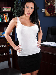 Gorgeous black haired milf Rachel Starr takes off her black skirt, sexy panties and beautiful bra