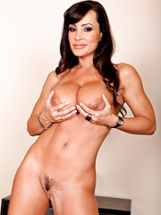 Slutty brunette whore Lisa Ann demonstrates her trimmed pussy and sweet tits