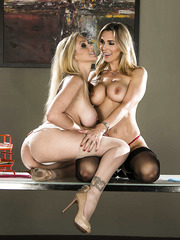 Pretty lesbian chicks Julia Ann and Tanya Tate play with each other's pussies