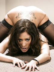 Beautiful and cute dark haired lady Capri Cavanni takes of her hot lingerie