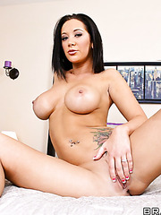 Busty brunette milf Jayden Jaymes plays with her gentle pussy on the bed