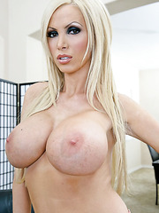 Crazy and passionate blonde lady Nikki Benz demonstrates her shaved pussy