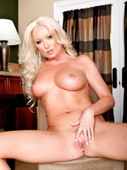 Pretty and nasty blonde whore Diana Doll demonstrates her super hot body