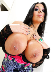 Crazy brunette bitch Sienna West demonstrates her huge boobs