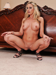 Cute and elegant blonde babe Sindy Lange takes off her sexy dress