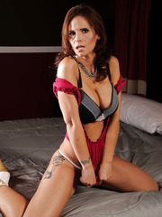 Passionate brunette mommy Syren De Mer rubs her trimmed pussy and masturbates