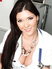 Dark haired doctor Claire Dames shows off her amazing big tits and hot tattooed body