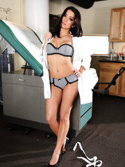 Black haired doctor Ann Marie Rios hides sexy lingerie and great body under her uniform