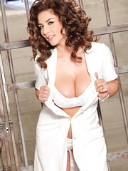 Curly-haired Roberta Gemma gets naked and shows off her great big tits
