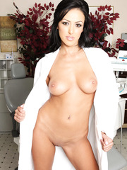 Black haired bombshell Breanne Benson takes off doctor's uniform and shows her sexy big tits