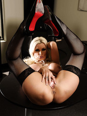 Busty and exciting blonde bombshell Brittany Andrews poses in really beautiful lingerie