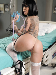 Short-haired, gorgeous and busty milf with hot tattoos Julia Bond is an amazing doctor