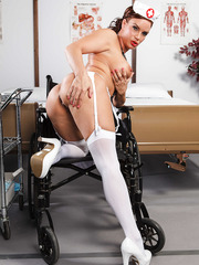 Mature nurse with seductive eyes and big tits Diamond Foxxx poses in her uniform