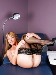 Hot mature Shayla Laveaux spreads her legs in sexy stockings to show trimmed snatch