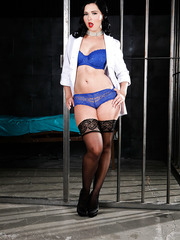 Jail doctor Angell Summers presents us amazing scene by taking of her lingerie