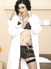 Slim, fair skinned and tattoed brunette nurse Veruca James in bitch-style stockings and skirt