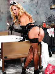 Dulcet blonde milf Cherie Deville looks seductively in her super hot whore-style uniform