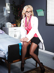 Glamorous and gorgeous nurse Phoenix Marie presents first-class striptease
