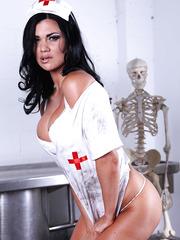 Busty brunette nurse Jasmine Jae shows her sexy ass and a great body