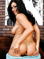 Pretty brunette mommy Angelica Raven spreads her legs and shows a juicy pussy