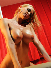Blonde babe with flawless busty body Blake Rose surprises with great pole dance