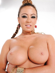 Busty babe with huge ass and sexy pigtail Mia Lelani gets naked and oils herself