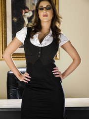 Hot office babe Kiera King takes off her uniform and poses in hot stockings