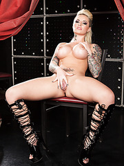 Tattooed fire with huge tits and sexy ass Christy Mack spreading her beautiful long legs