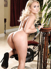 Beautiful blonde Alexis Monroe demonstrates her shaved pussy and a sexy boobs