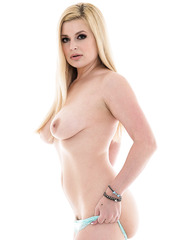 Marvellous blonde babe with big tits Danielle Delaunay spreads her plump butt