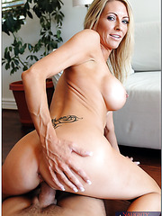 Gorgeous bitch Emma Starr undresses her sexy black lingerie and gets a cock
