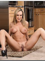 Stunning model Brandi Love showing sexy legs and reaching satisfaction