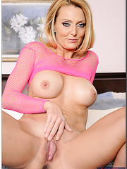 Unforgettable wanton Brenda James likes posing and fingering pussy