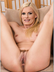 Obedient pornstar Darryl Hanah showing trimmed pussy and making it wet