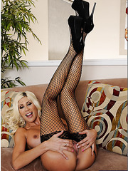 Magnificent blonde Puma Swede posing in black stockings and fingering