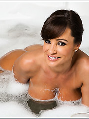Crazy housewife Lisa Ann taking a hot bath and playing with her boobs