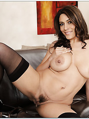 Cheeky slut Raylene adores showing big boobs and posing in stockings