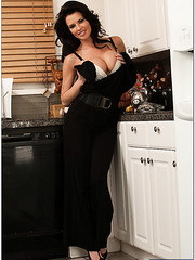 Attractive pornstar Veronica Avluv showing hot lingerie in the kitchen