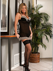Passionate mom Kristal Summers posing in stockings and playing with tits
