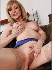 Nasty whore Nina Hartley prefers stripping in lingerie and fingering