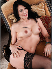 Swanky chick Zoey Holloway loves posing naked and playing with boobs