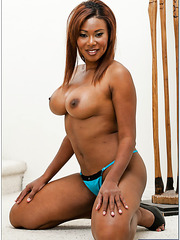 Seductive ebony Jessica Dawn showing delicious boobies and fingering snatch