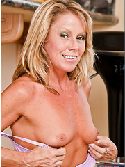 Noteworthy coquette Nikki Charm stripping and masturbating like in her youth