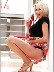 Appealing minx Emma Starr showing yummy melons and posing in her house