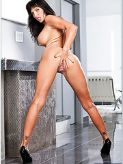 Obedient pornstar Lezley Zen posing and demonstrating her hot forms